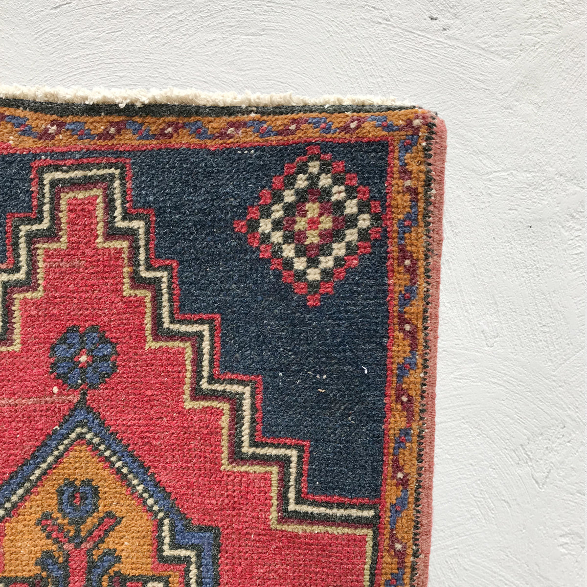 Red, white and blue...and gold! This vintage Turkish rug is great for entryways, bathrooms, kitchens and layering. 20x39 inches.
