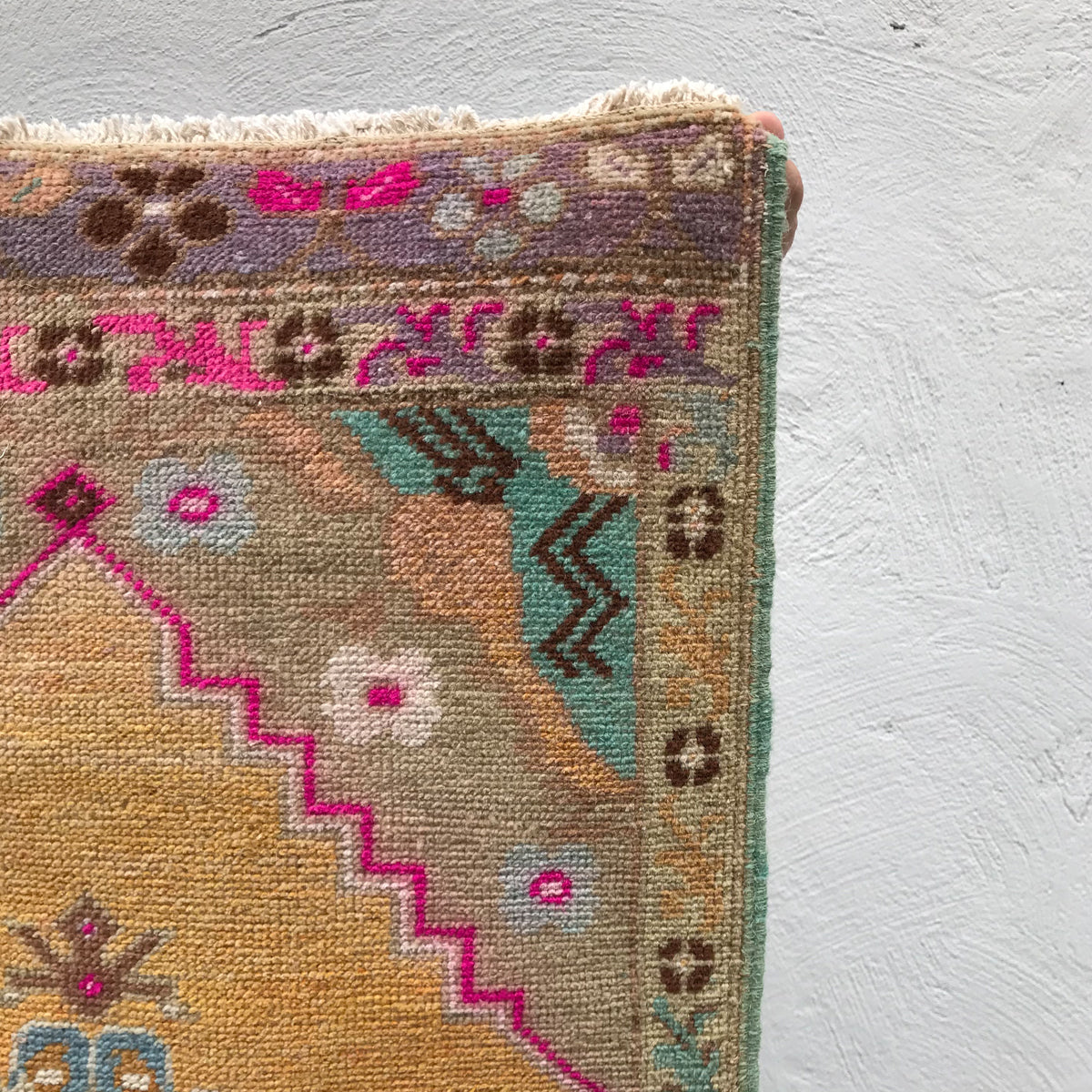 This small handwoven vintage Turkish rug has a great length and fun colors. Great for entryways, bathrooms, kitchens and layering. 21x45 inches.