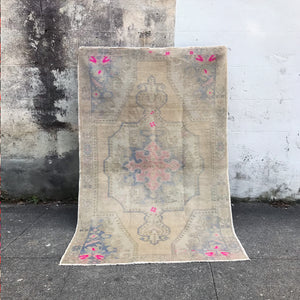 This handwoven vintage Turkish rug has spectacular soft colors and pops of pink. 54x81 inches.