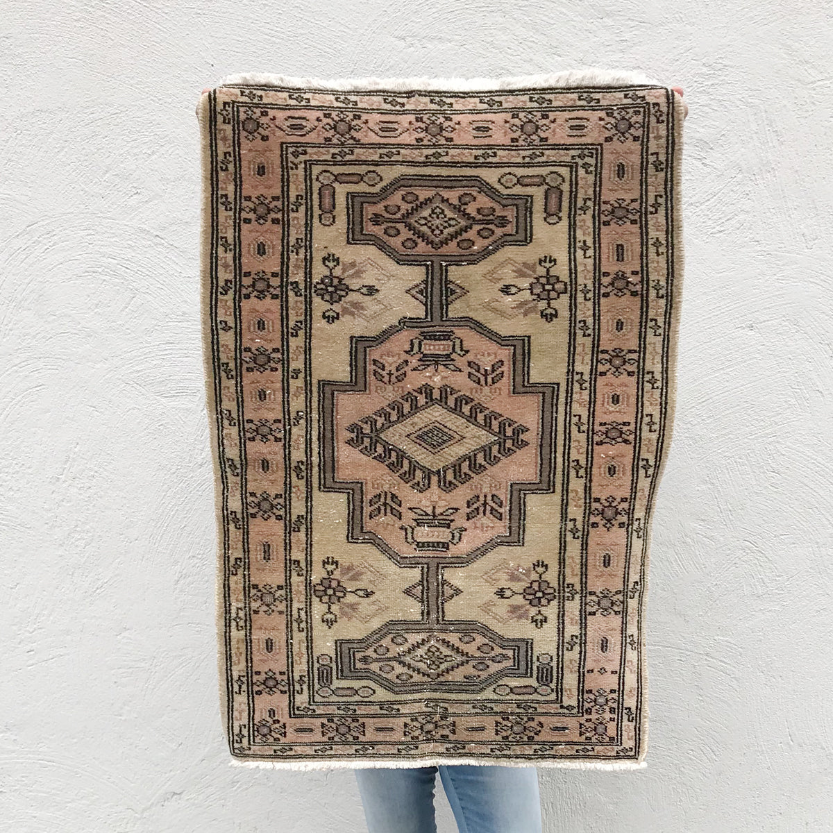 This small handwoven vintage Turkish rug has great blush colors. Great for entryways, bathrooms, kitchens and layering. 24x33 inches.