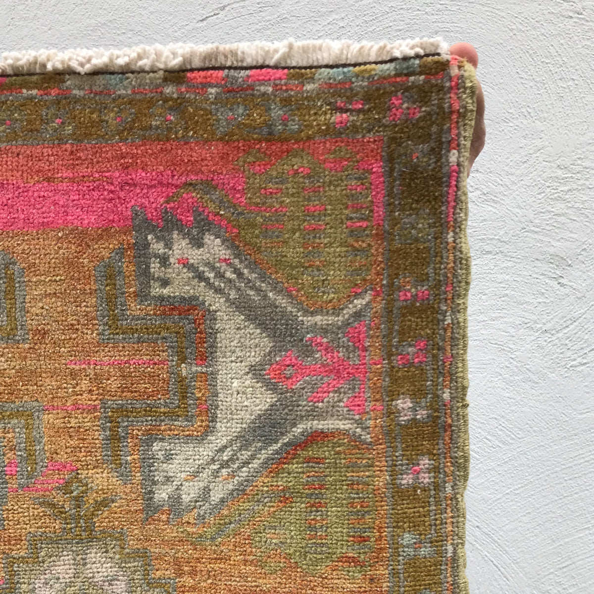 This small handwoven vintage Turkish rug has gorgeous color! Great for entryways, bathrooms, kitchens and layering. 20x38 inches.