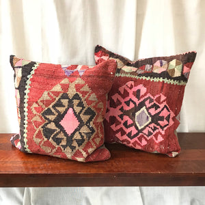 This beautiful pair of 24x24 Kilim pillowcases are cut from the same kilim rug.  Our pillowcases are made from recycled handwoven vintage Turkish kilims.  Zipper closure. Insert not included. Natural dyes. Wool. Each pillow is one of a kind.
