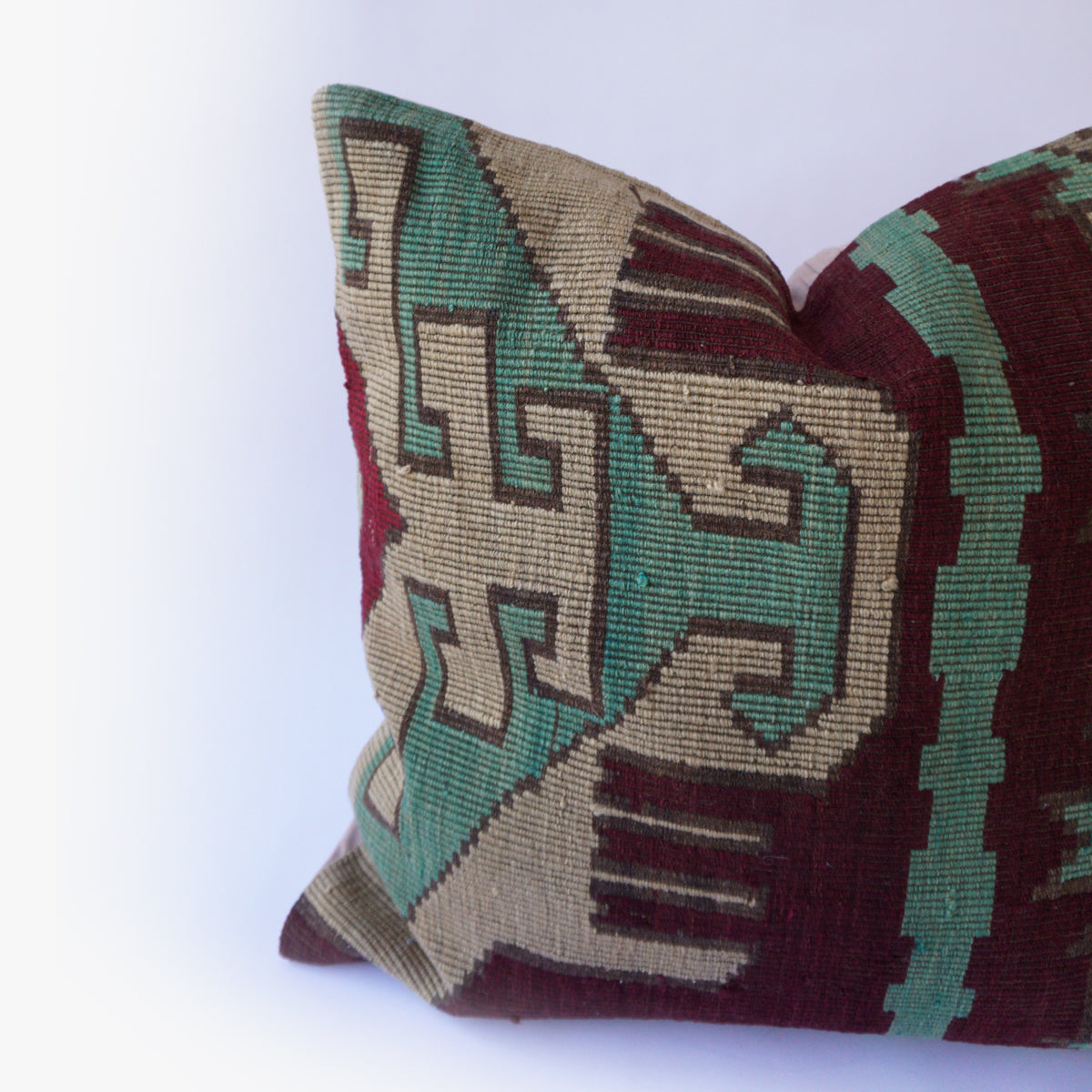 24x24 Kilim pillowcase made from recycled handwoven vintage Turkish kilims.  Zipper closure. Insert not included. Natural dyes. Wool. One of a kind.   Colors include tan, green, maroon and pink.
