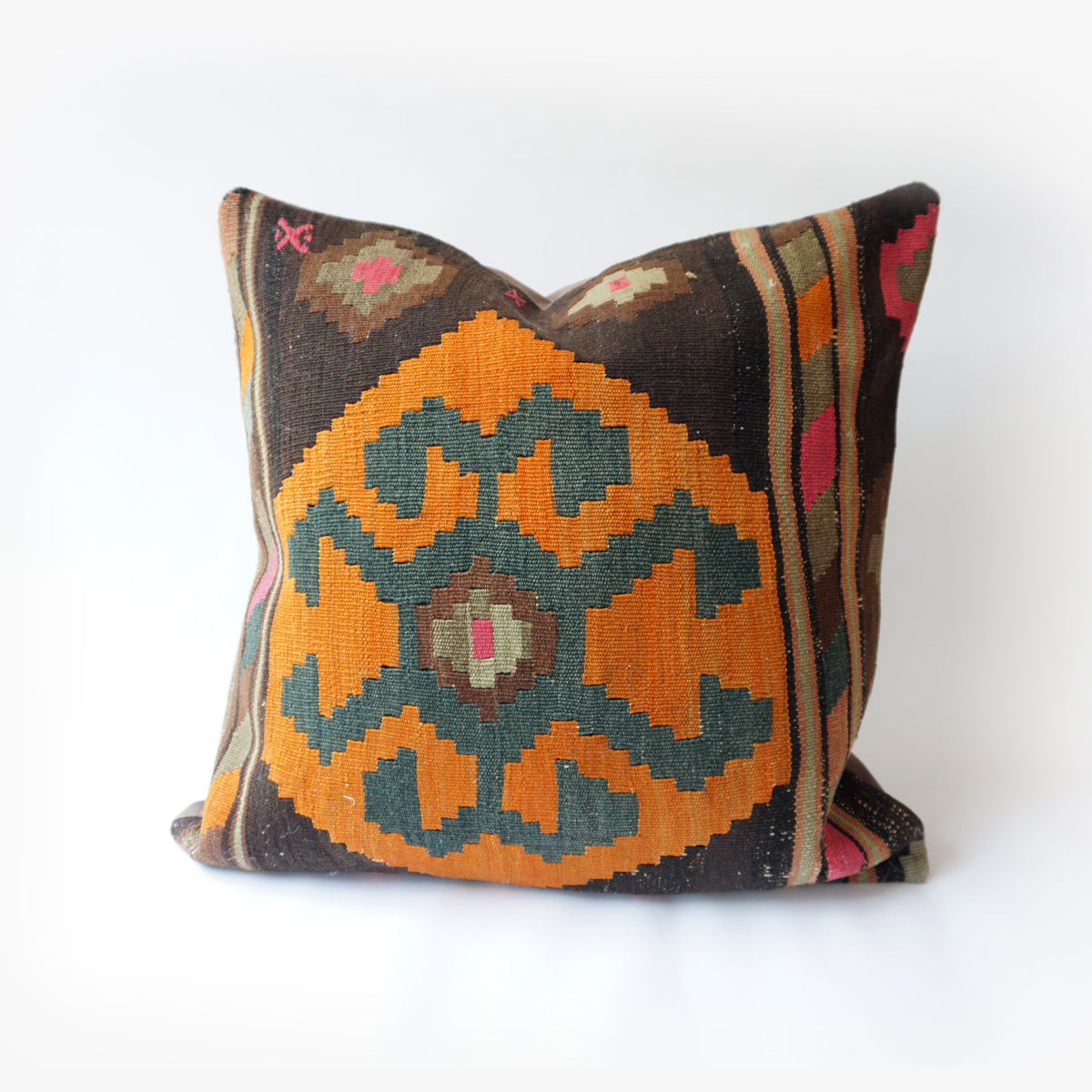 24x24 Kilim pillowcase made from recycled handwoven vintage Turkish kilims.  Zipper closure. Insert not included. Natural dyes. Wool. One of a kind.   Colors include Brown, Orange, Green, Pink, Olive and Tan.