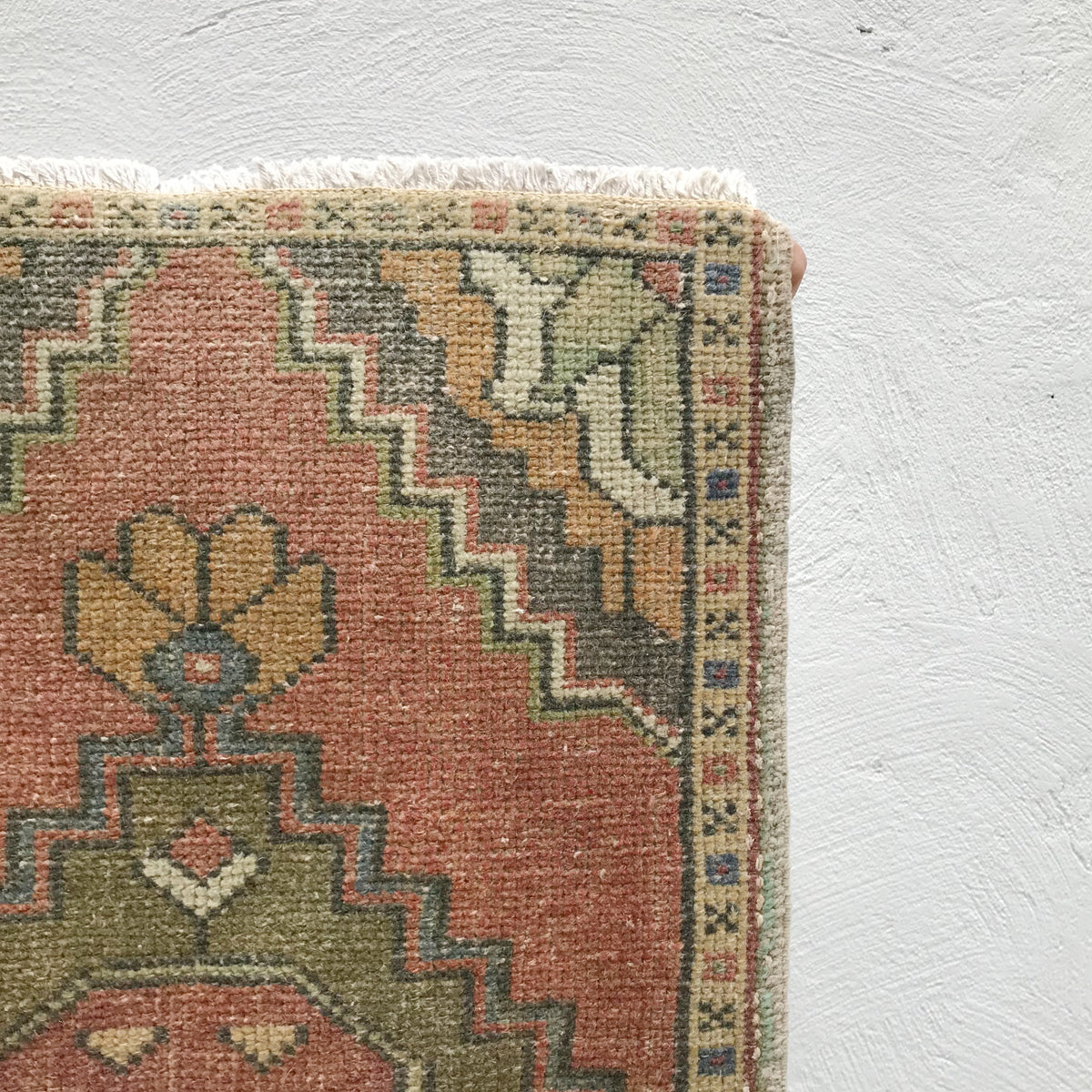 This small handwoven vintage Turkish rug has great muted colors. Great for entryways, bathrooms, kitchens and layering. 18.5x34 inches.