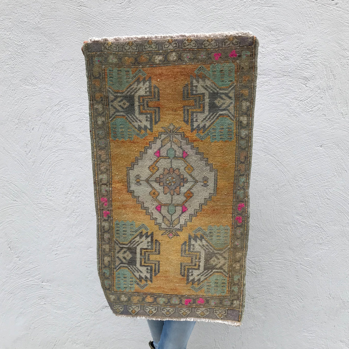 This small handwoven vintage Turkish rug has gorgeous warm colors! Great for entryways, bathrooms, kitchens and layering. 20x35 inches.