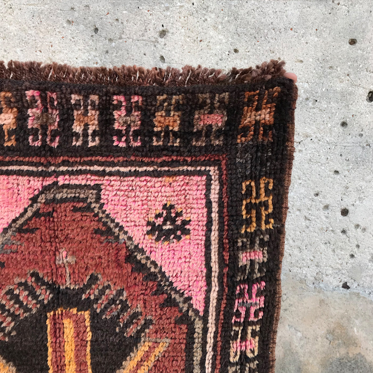 This small vintage Turkish rug has a soft pile and amazing pinks! Cozy up a bathroom with this beauty! 22x38 inches.