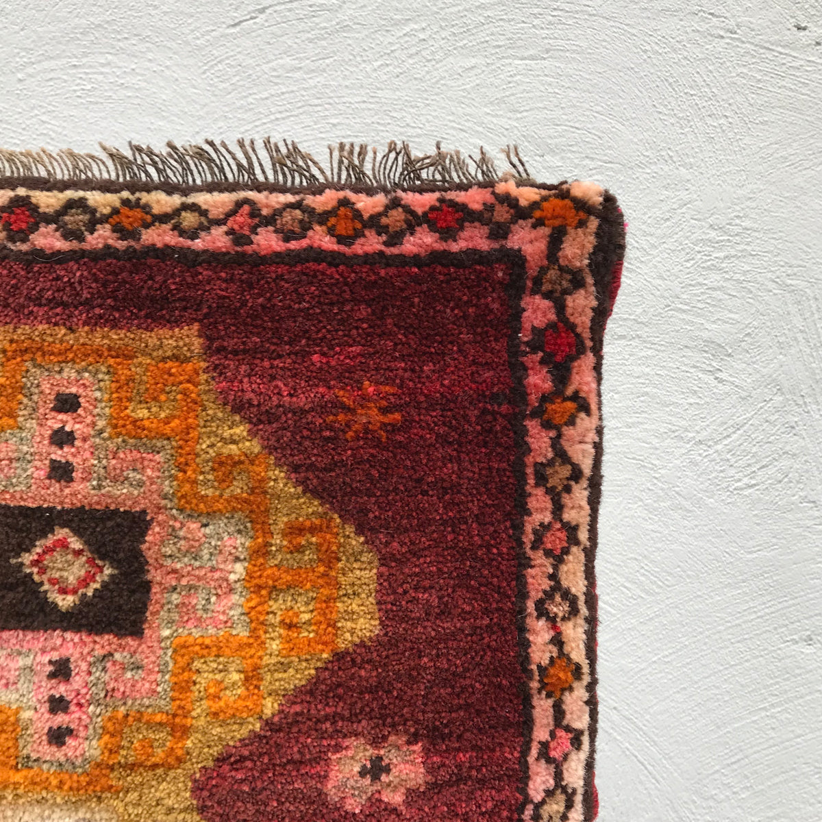 This small handwoven vintage Turkish rug has great colors including pink. Great for entryways, bathrooms, kitchens and layering. 18.5x30 inches.