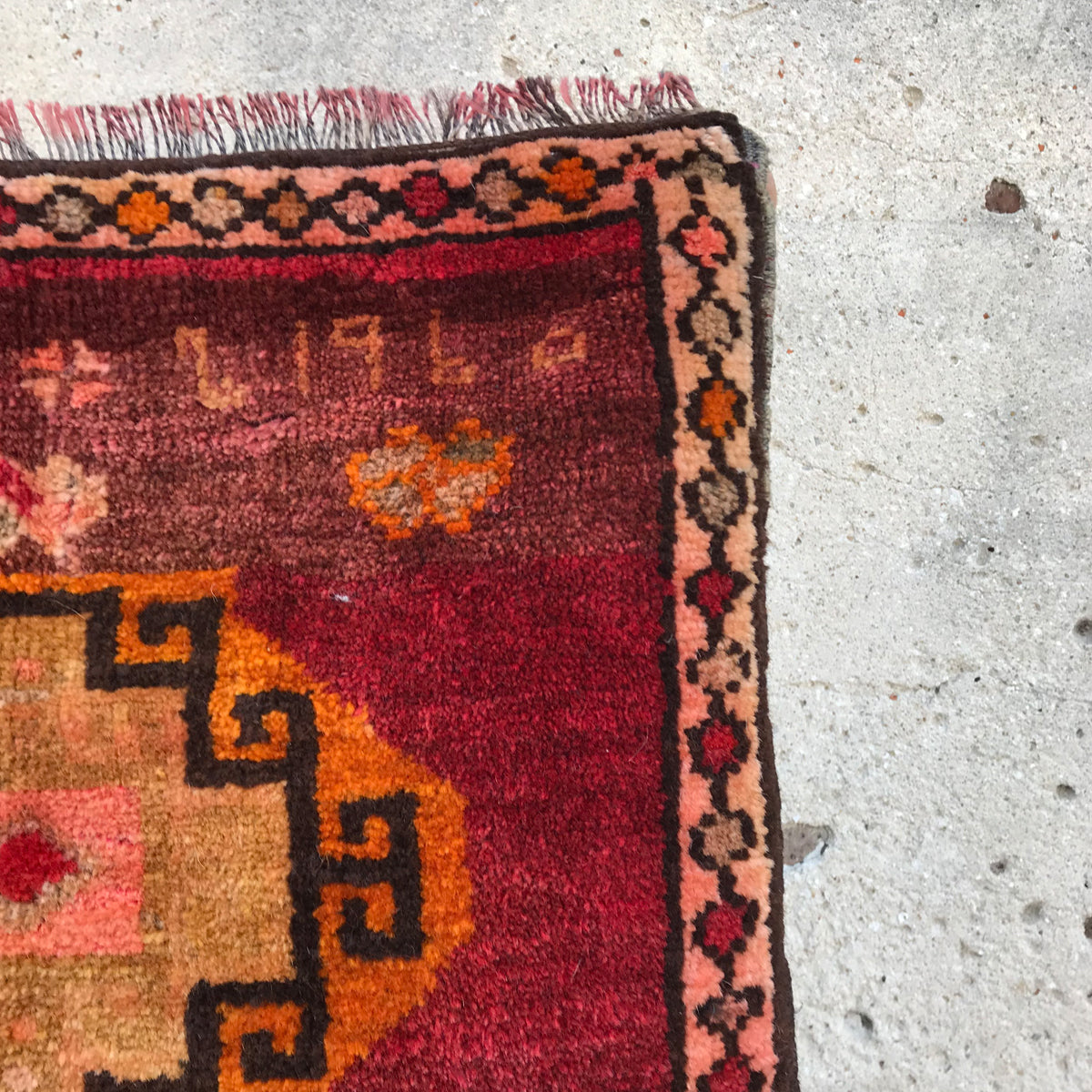 1960. Sometime you can find a date and/or a name woven into a vintage Turkish rug. This one was completed in 1960, and the date is woven into a corner.  What a find! Beautiful pinks are throughout the design. 19x30 inches.