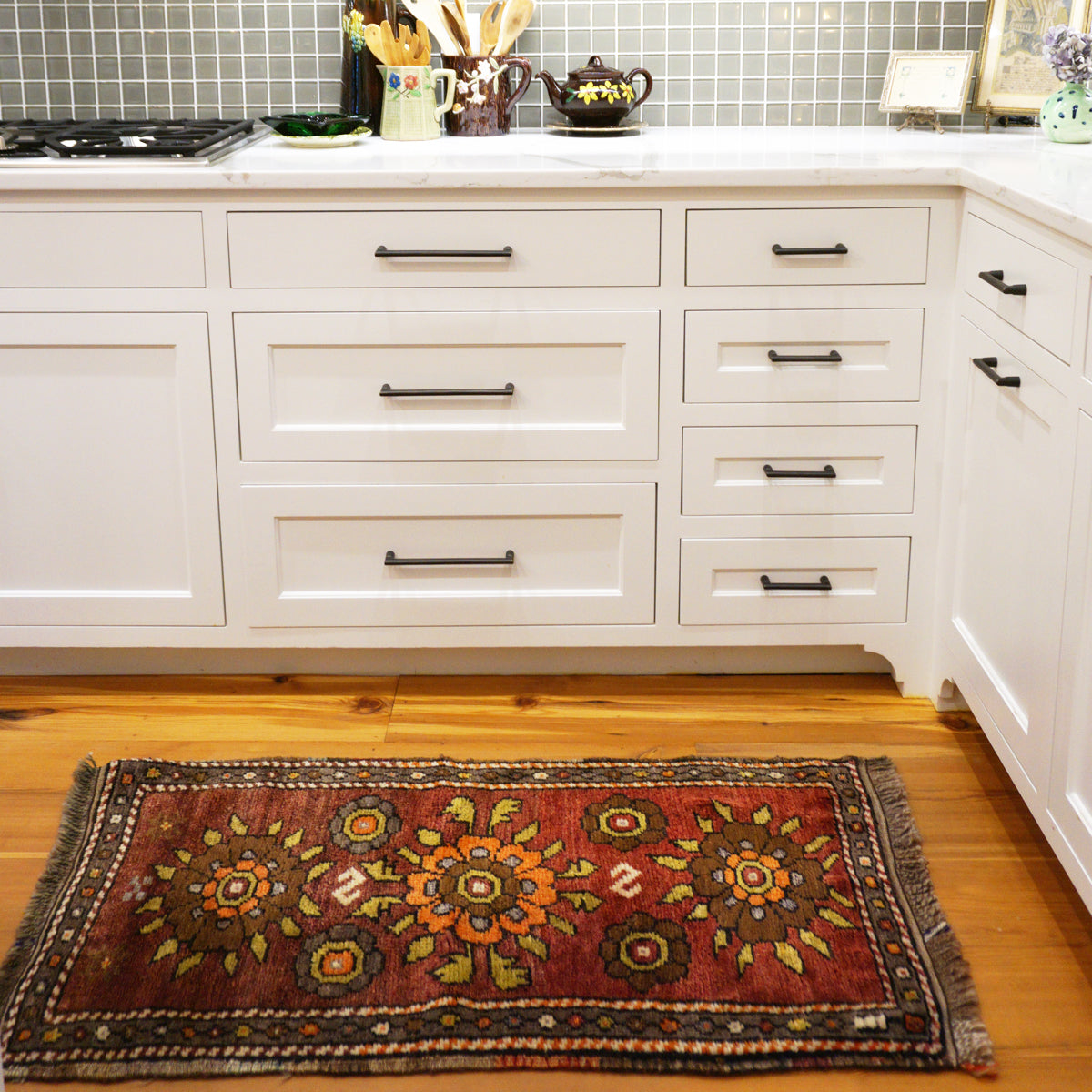 The 36 Flowers Vintage Turkish rug is filled with warm colors and is perfect for kitchens, bathrooms and entryways. 25x45 inches.