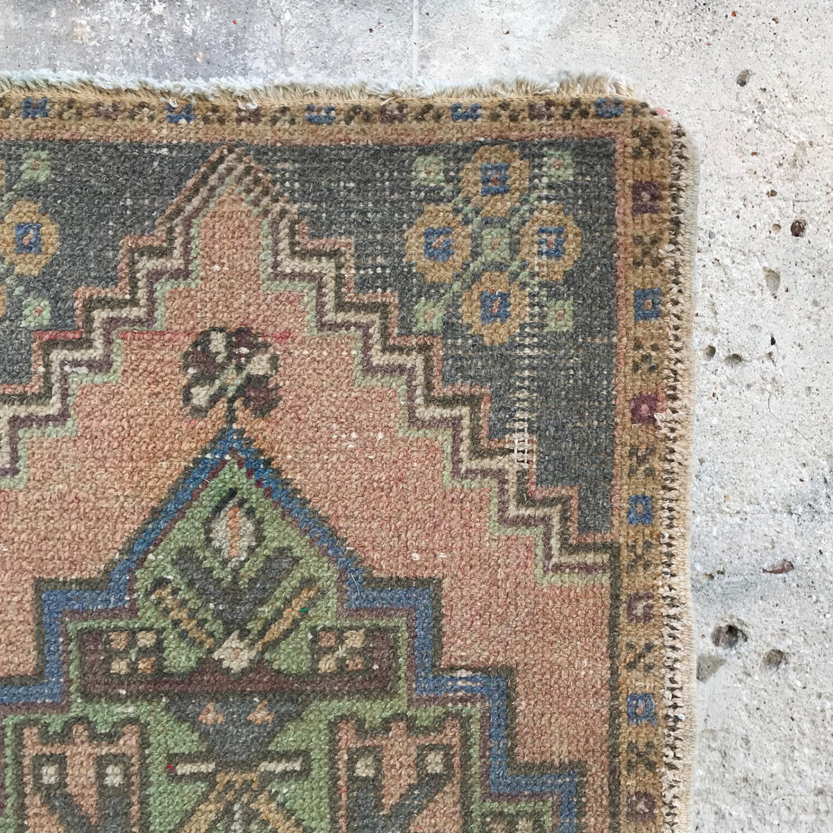 This small handwoven vintage Turkish rug has a great blush and grayish blue colors. Great for entryways, bathrooms, kitchens and layering. 20x38 inches.