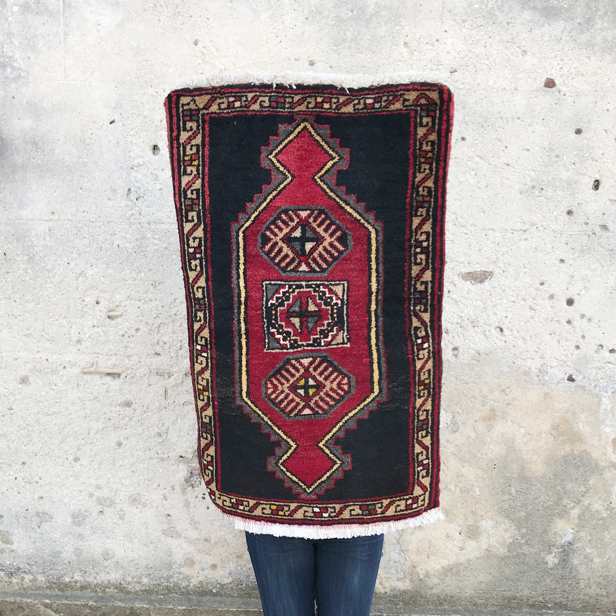 This vintage Turkish rug is small but bold with a graphic geometric design. 20x32 inches.