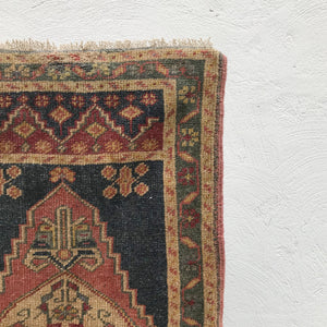 This small handwoven vintage Turkish rug has a great length and beautiful colors. Great for entryways, bathrooms, kitchens and layering. 23x46 inches.
