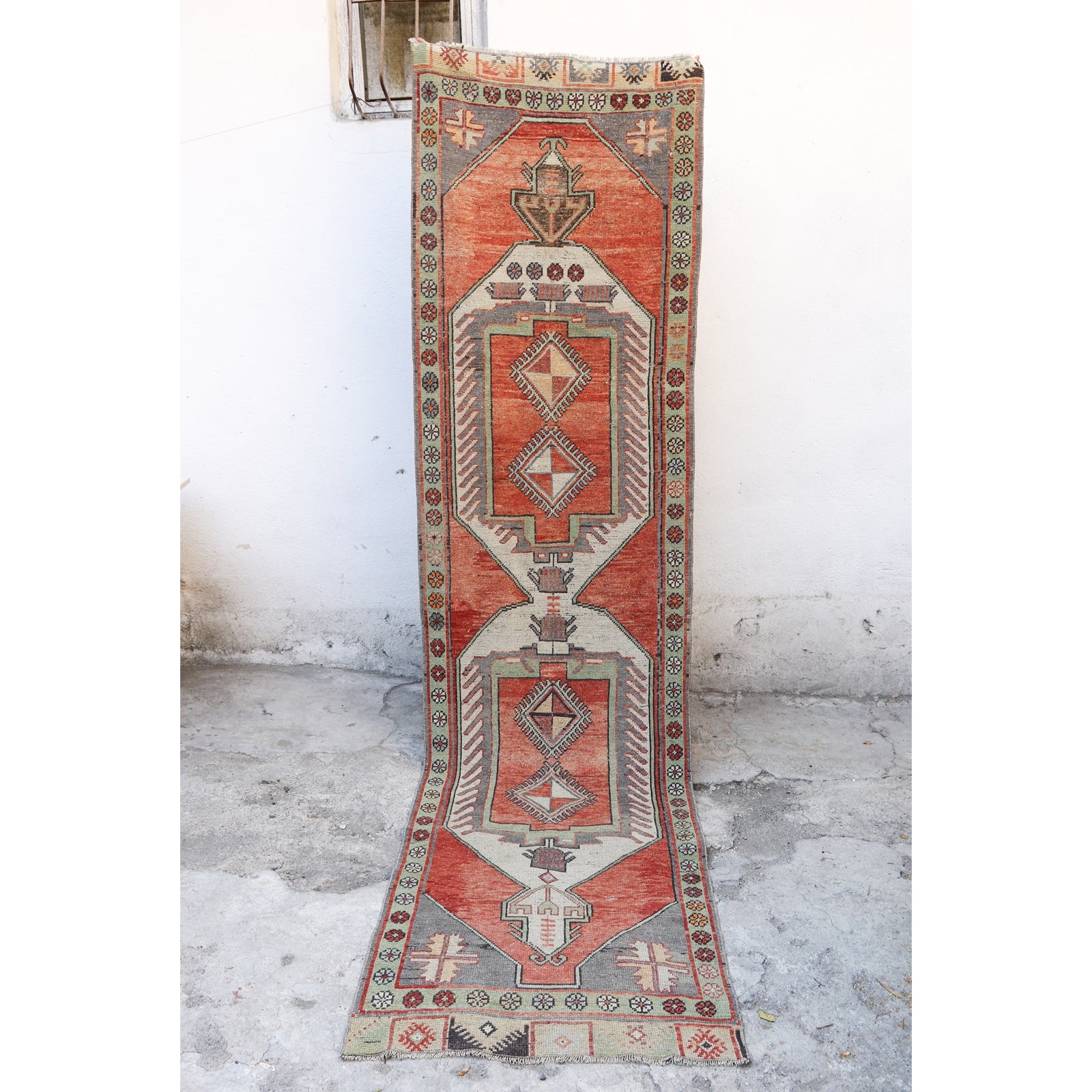 This handwoven vintage Turkish rug has beautiful warm tones of soft red, gray blue, green and neutral. Konya.