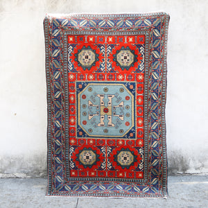 This handwoven vintage Turkish rug has gorgeous, vibrant, original colors.  Warm red, shade of dark and light blue, and neutral accents. Kafkas.