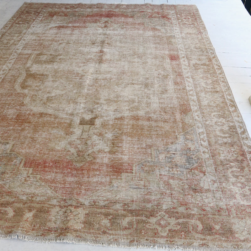 This handwoven vintage Turkish rug is from has a beautiful field of coral with neutral accents. Bor.