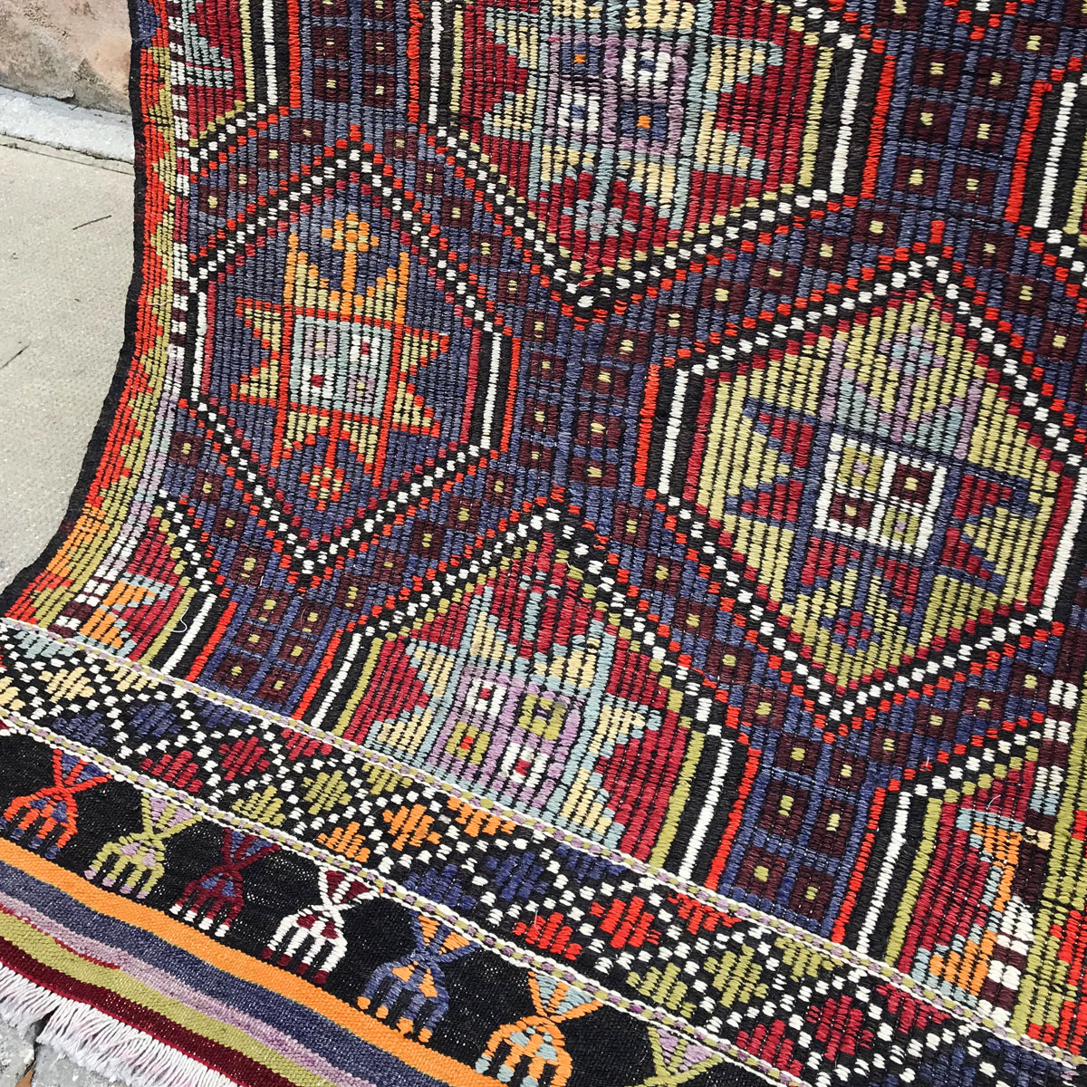 This Cicim handwoven vintage Turkish rug has amazing colors and pattern on a black background.  Cicim rugs have embroidery used in their technique. Great colors, design and history. 32 x 48 inches.