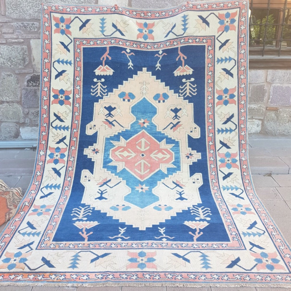 This tribal handwoven vintage Turkish rug is from the Kars region has absolutely stunning pinks and blues.  7'8x11'