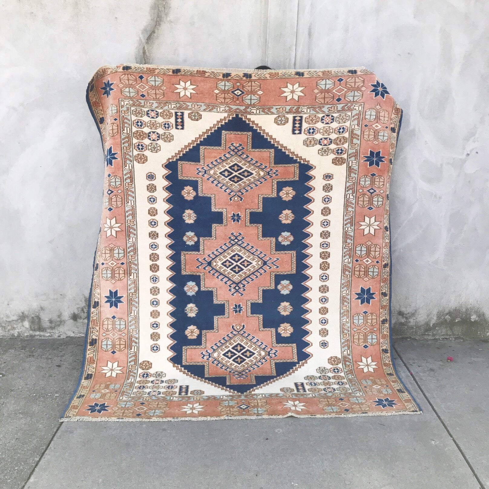 This tribal handwoven vintage Turkish rug is from the Kars region has absolutely stunning peaches, pinks, and blues. 5'5x6'6.
