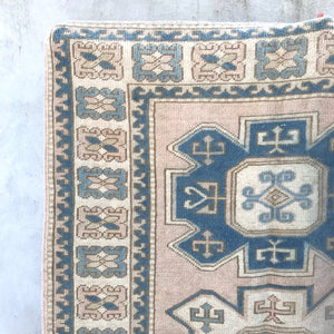 This tribal handwoven vintage Turkish rug is from the Kars region has absolutely stunning blushes and blues. 4'3x6'5.