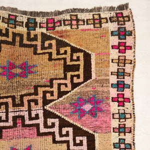 This tribal handwoven vintage Turkish rug has gorgeous, vibrant colors.  Thick, soft pile. Warm neutral camel colors with brown, hot pink, and teal accents. Herki.