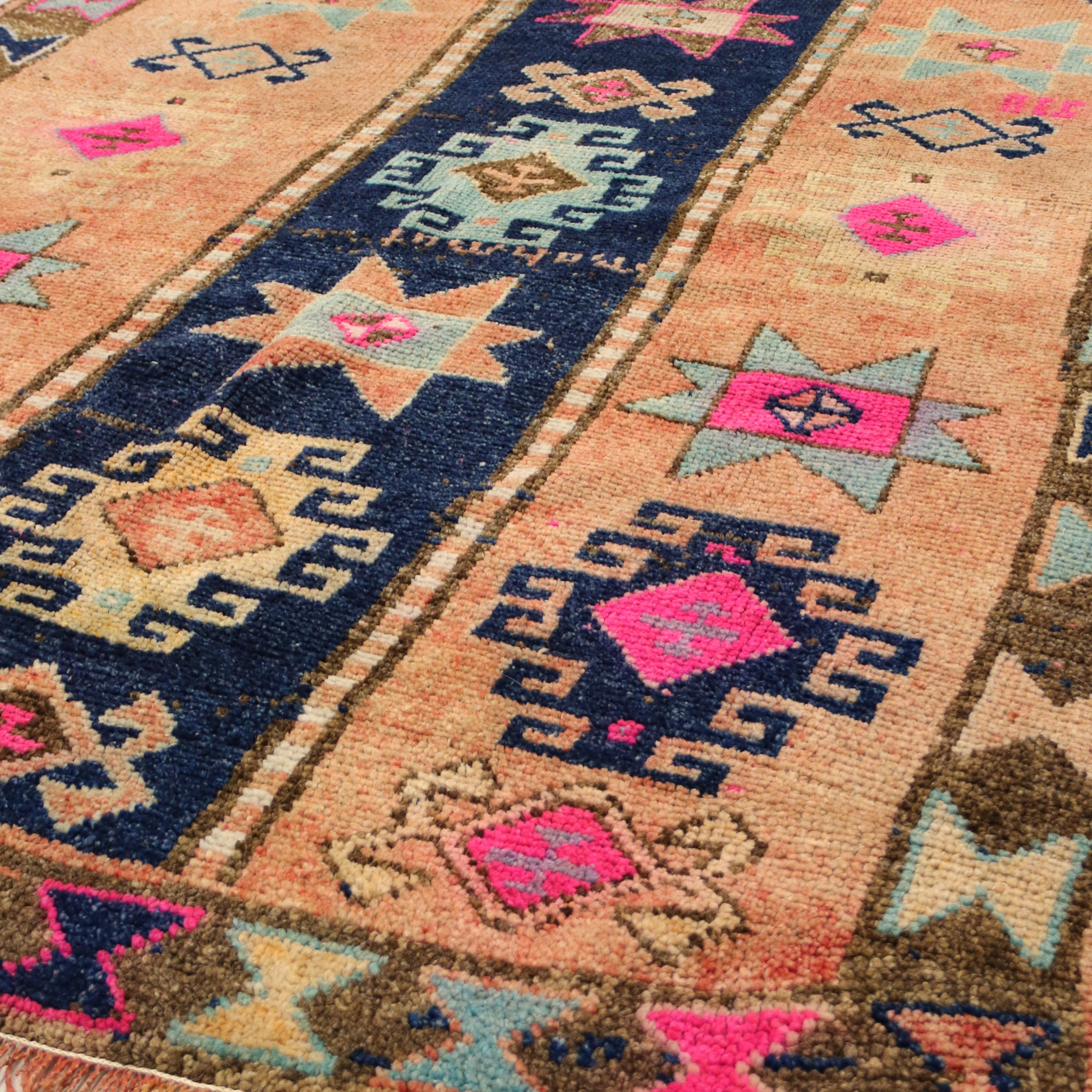 This tribal handwoven vintage Turkish rug has gorgeous, vibrant colors.  Thick, soft pile. Navy, rust/peach, hot pink, olive, and light blue. Herki.