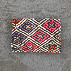 Beautiful kilim clutch made from recycled handwoven vintage Turkish kilims.  Zippered interior pocket. Snap closure. Natural dyes. Wool. One of a kind.   Because of the age of the textiles, some clutches have light wear but this just enhances the character and does not affect the quality.   Approximately 11.5 x 8 inches.  Fits a 9.7 inch iPad.