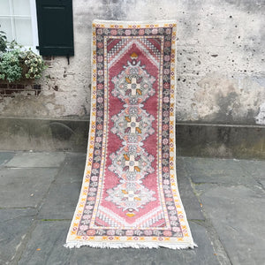 This vintage Turkish runner has great pinks, yellows, and grays.  The pile is nice and cozy on this rug! 39x111 inches.