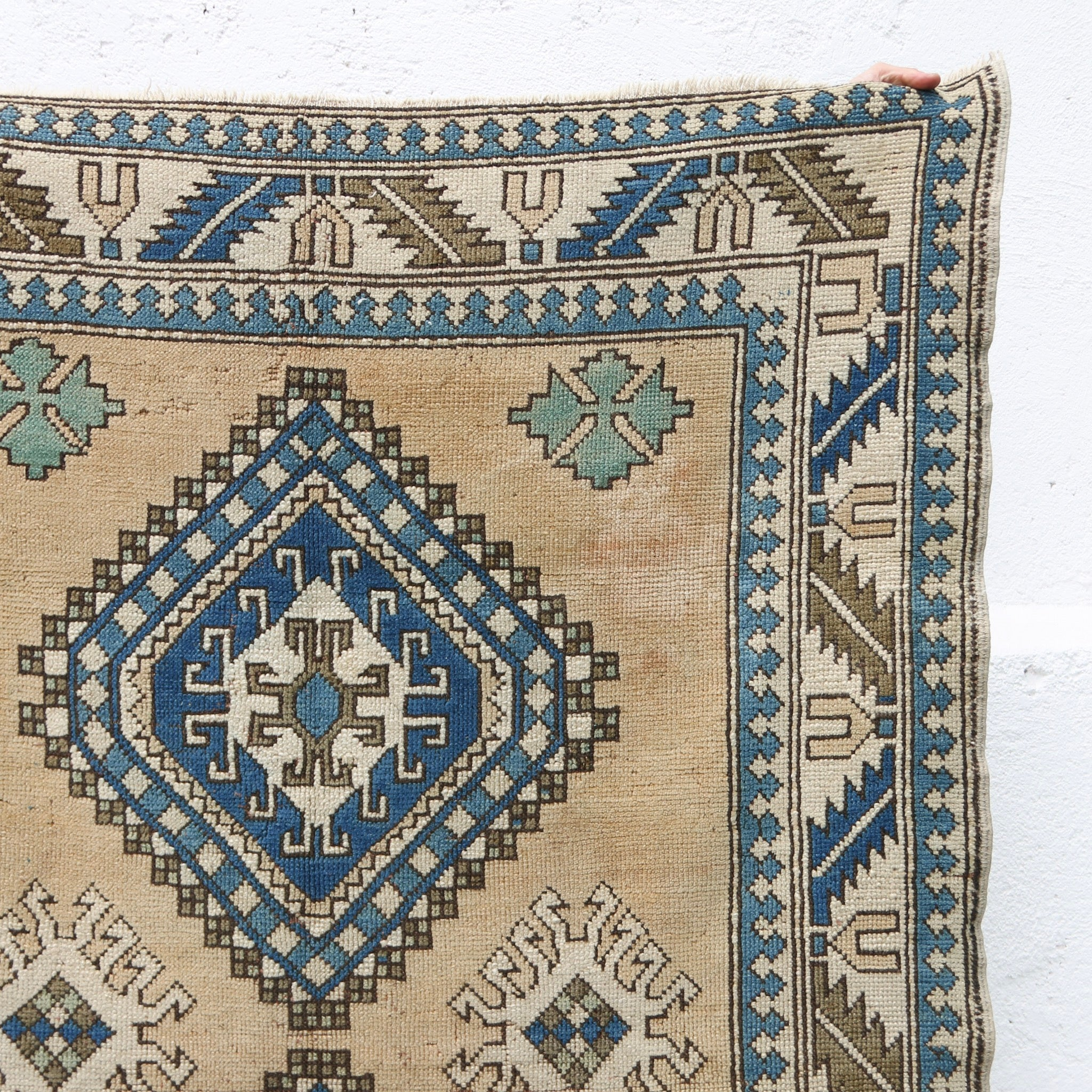 This handwoven vintage Turkish rug is a great neutral with blue, green, and olive accents. Kars.
