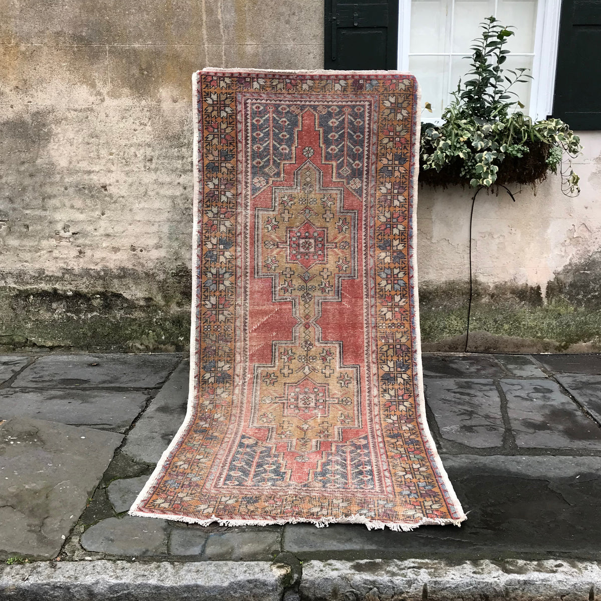 This beautiful handwoven vintage Turkish rug is almost 9 feet long.  Warm rust and dark blue/grays make this piece warm and beautiful. 51x105 inches.