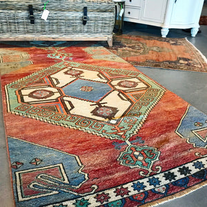 This beautiful handwoven vintage Turkish rug is a hard to find design and color combination. 41x142 inches.