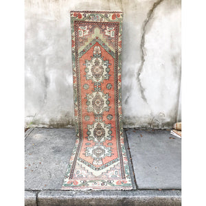 This vintage Niğde Turkish runner is a great size and has fantastic muted rust and blue colors! 2'4x9'6