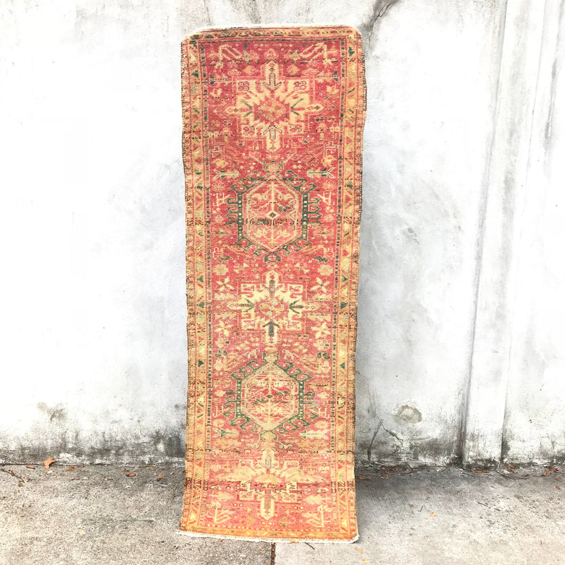 This handwoven vintage Turkish rug has beautiful pinks with green and neutral accents. Nevşehir.