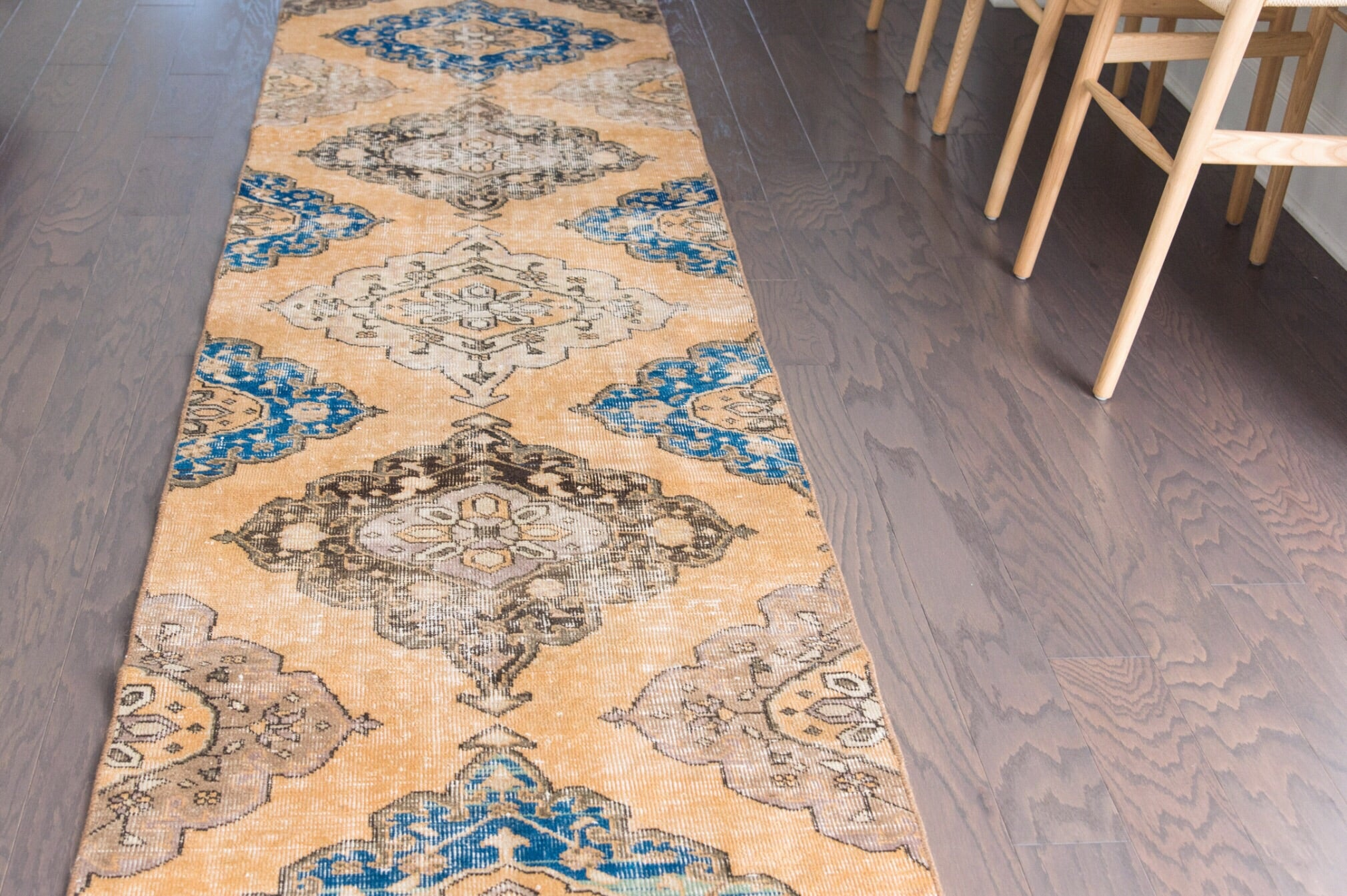 This vintage Turkish runner is a stunner! Amazing peach background with beautiful blue accents. 2'10x12'7