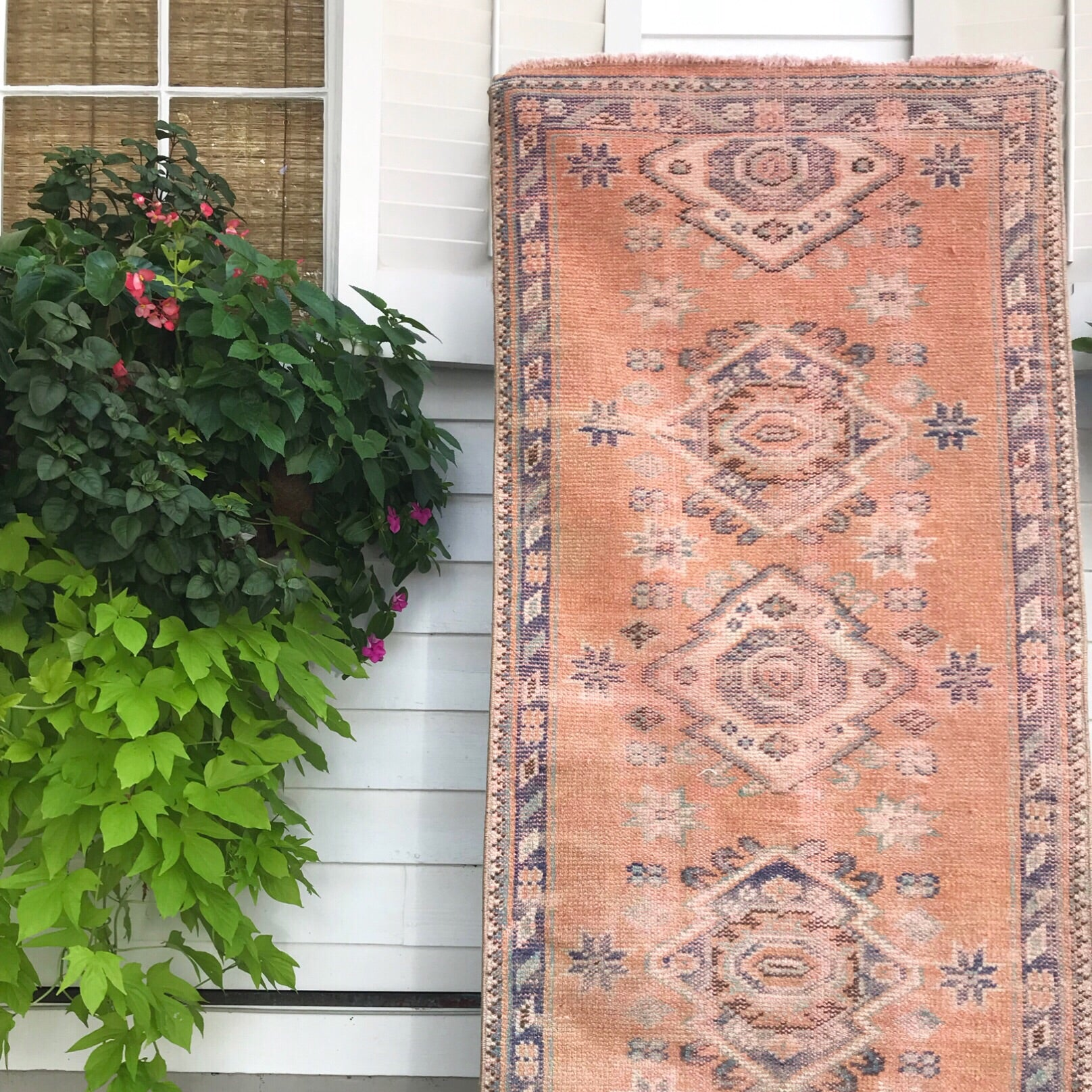 This vintage Uşak Turkish runner is an amazing peachy orange with vibrant blue, purple, and even pink accents!  2'5x12'8