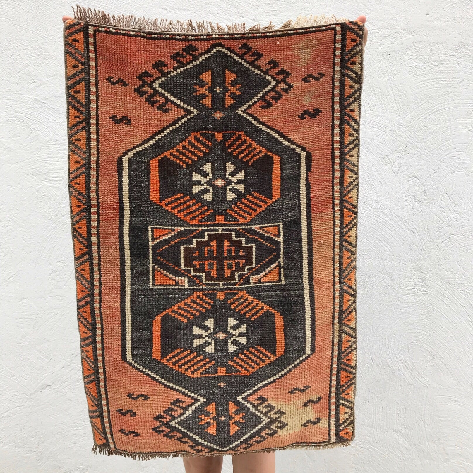 This small handwoven vintage Turkish rug has a great design and warm colors. Super soft pile. Great for entryways, bathrooms, kitchens and layering. 26x36""