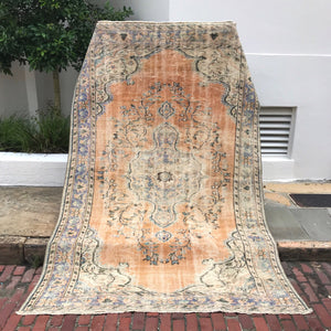 This large vintage Turkish rug is a beautiful gold with teal and purple accents!  5'10x8'11