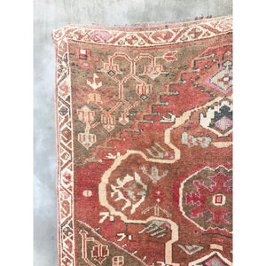 This tribal Herki handwoven vintage Turkish rug has absolutely stunning pinks and reds with blue, green, and neutral accents.  5'1x9'3