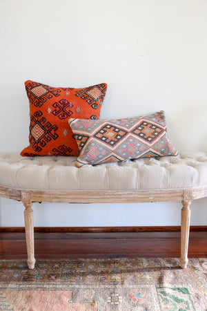 Cicim rugs have embroidery and beautiful detail. Our pillowcases are made from recycled handwoven vintage Turkish kilims.  Zipper closure. Insert not included. Natural dyes. Wool. Each pillow is one of kind.   Pink, rust, blue, charcoal, cream. 12x24.