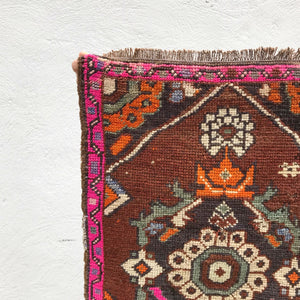 This small handwoven vintage Turkish rug has a great  colors and pops of pink. Super soft pile. Great for entryways, bathrooms, kitchens and layering. 20x33""