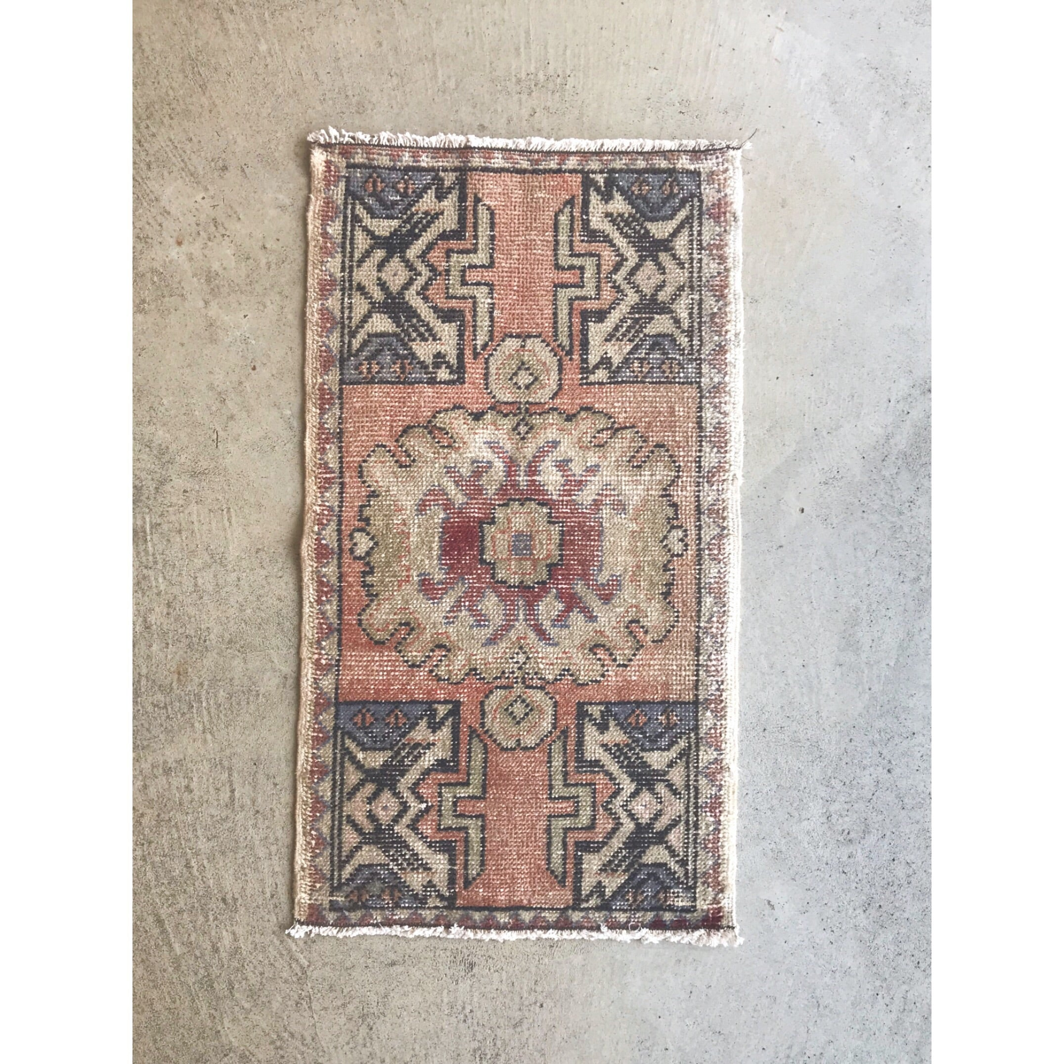 This small handwoven vintage Turkish rug has great warm colors. Perfecr for entryways, bathrooms, kitchens and layering. 19x35""
