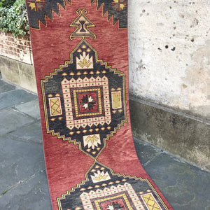 This vintage Turkish runner is a stunner! Gray and red with an amazing accent colors and design. 3x11'6.
