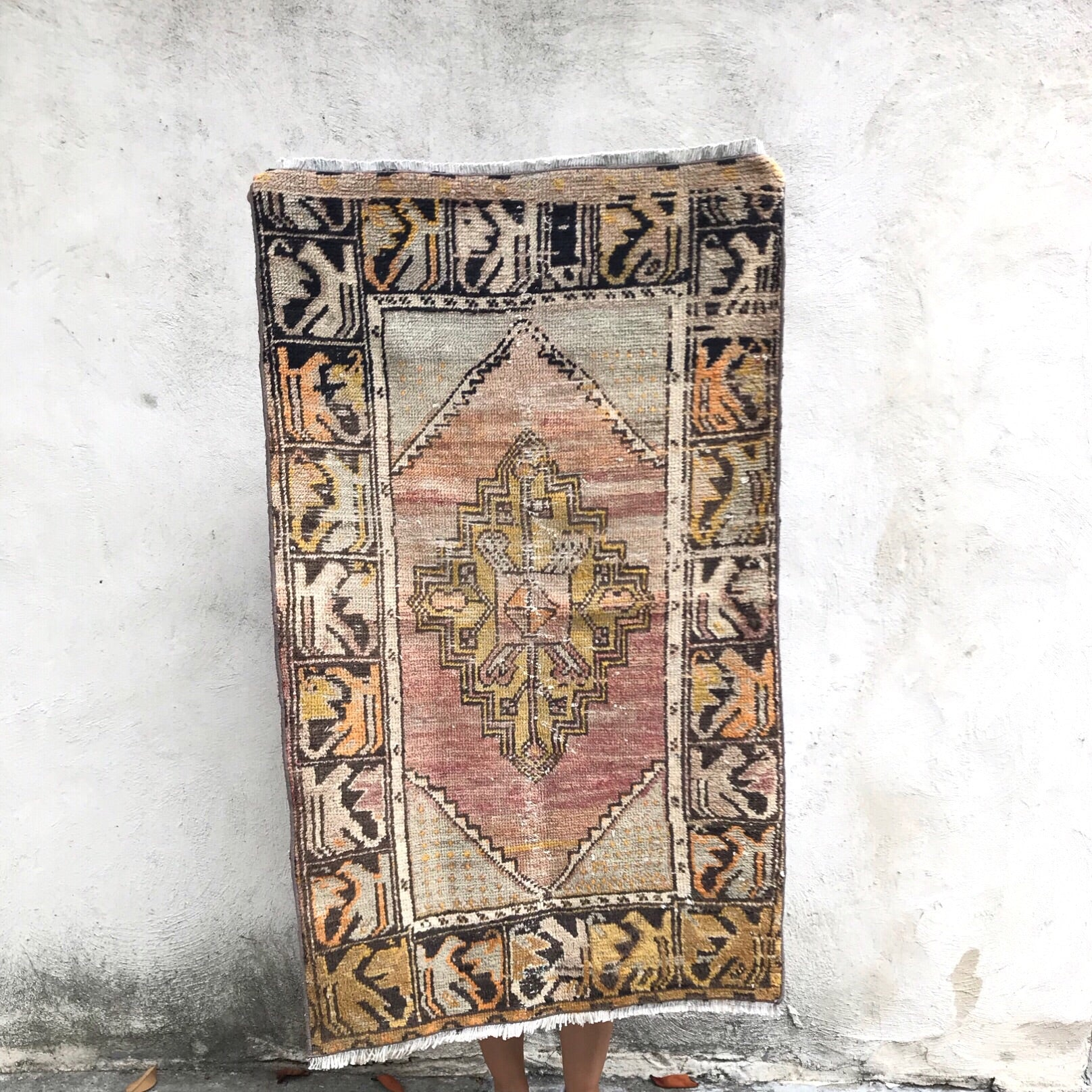This handwoven vintage Turkish rug has warm colors with black and cream accents. Perfect size for kitchen or bath!  2'4x4'1