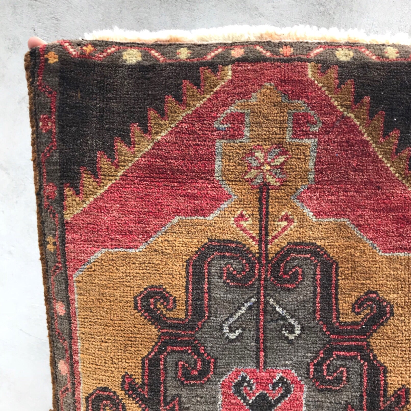 This vintage Yastik is a beautiful rich gold, charcoal, black and salmon.  Super soft pile. Great for entryways, bathrooms, kitchens and layering. 1'6x3