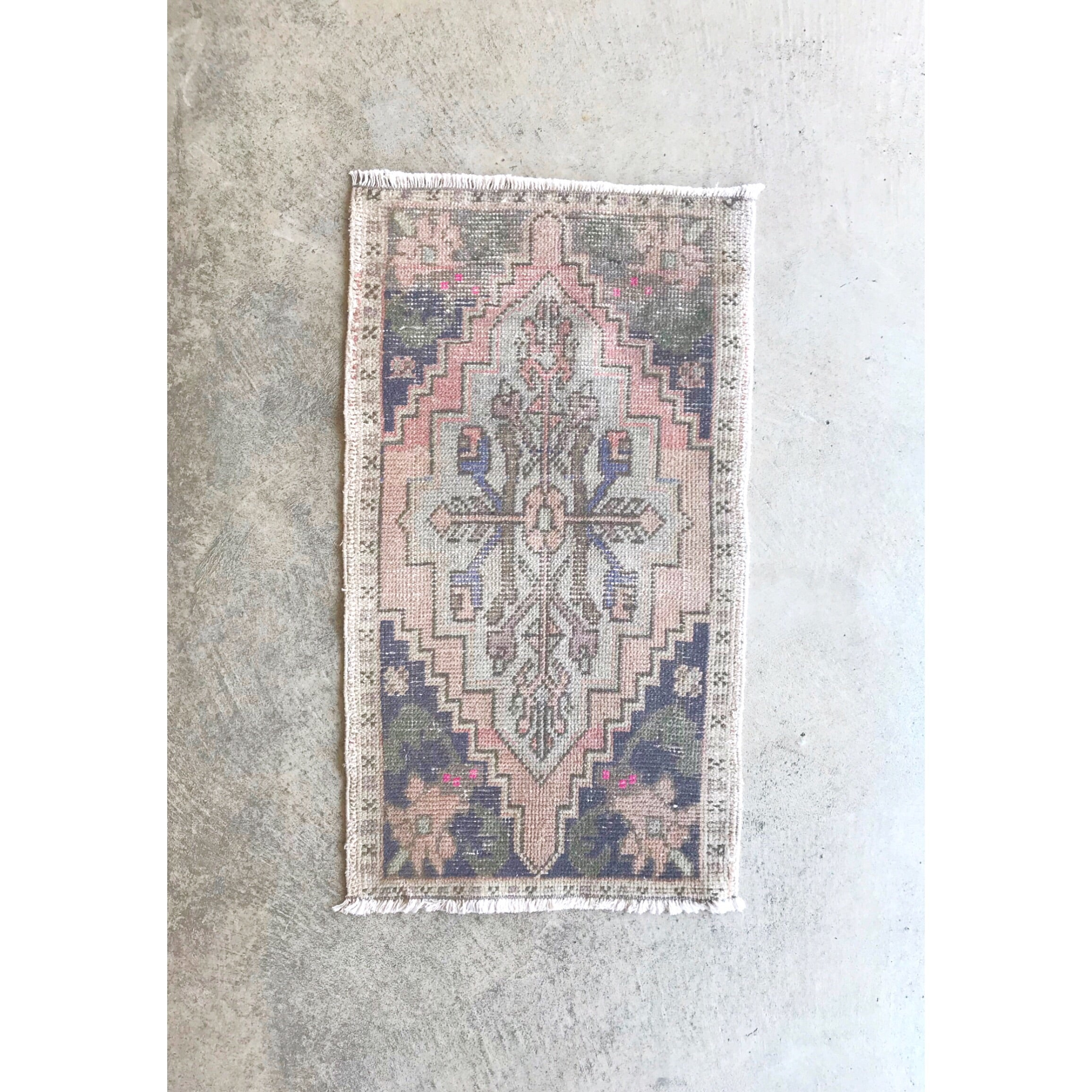 This small handwoven vintage Turkish rug has great pink colors. Perfect for entryways, bathrooms, kitchens and layering. 20x36""