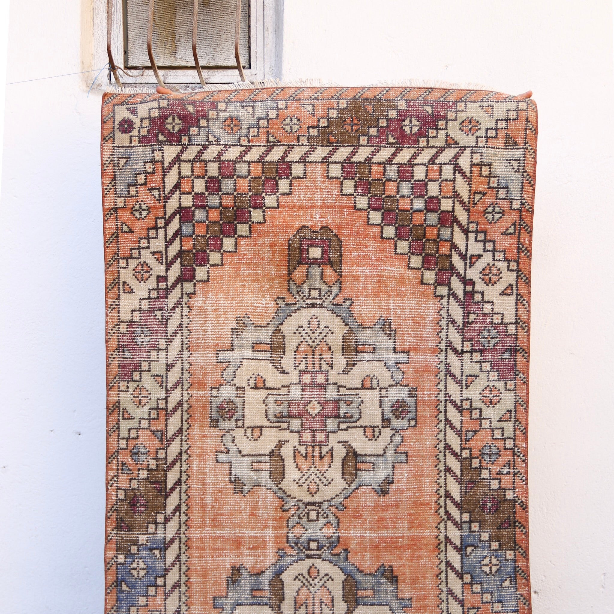This handwoven vintage Turkish rug has beautiful warm colors. Periwinkle and purple accents. Niğde.