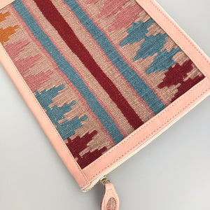 Our clutches are handmade in Turkey using vintage kilims and leather. Each bag is one of a kind. Leather side has an extra pocket and interior is fully lined. The sling handle is removable. 10 1/4 x 8 1/2.