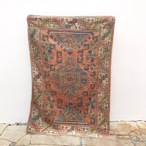 This 4x5 handwoven vintage Turkish rug has beautiful peach, blue, and gold colors. Super soft pile. Great for entryways, bathrooms, kitchens and layering. 4'1x5'10