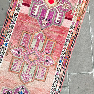 This handwoven vintage Turkish rug has amazing color change - abraj - with pinks and gold and a thick soft pile. Herki.