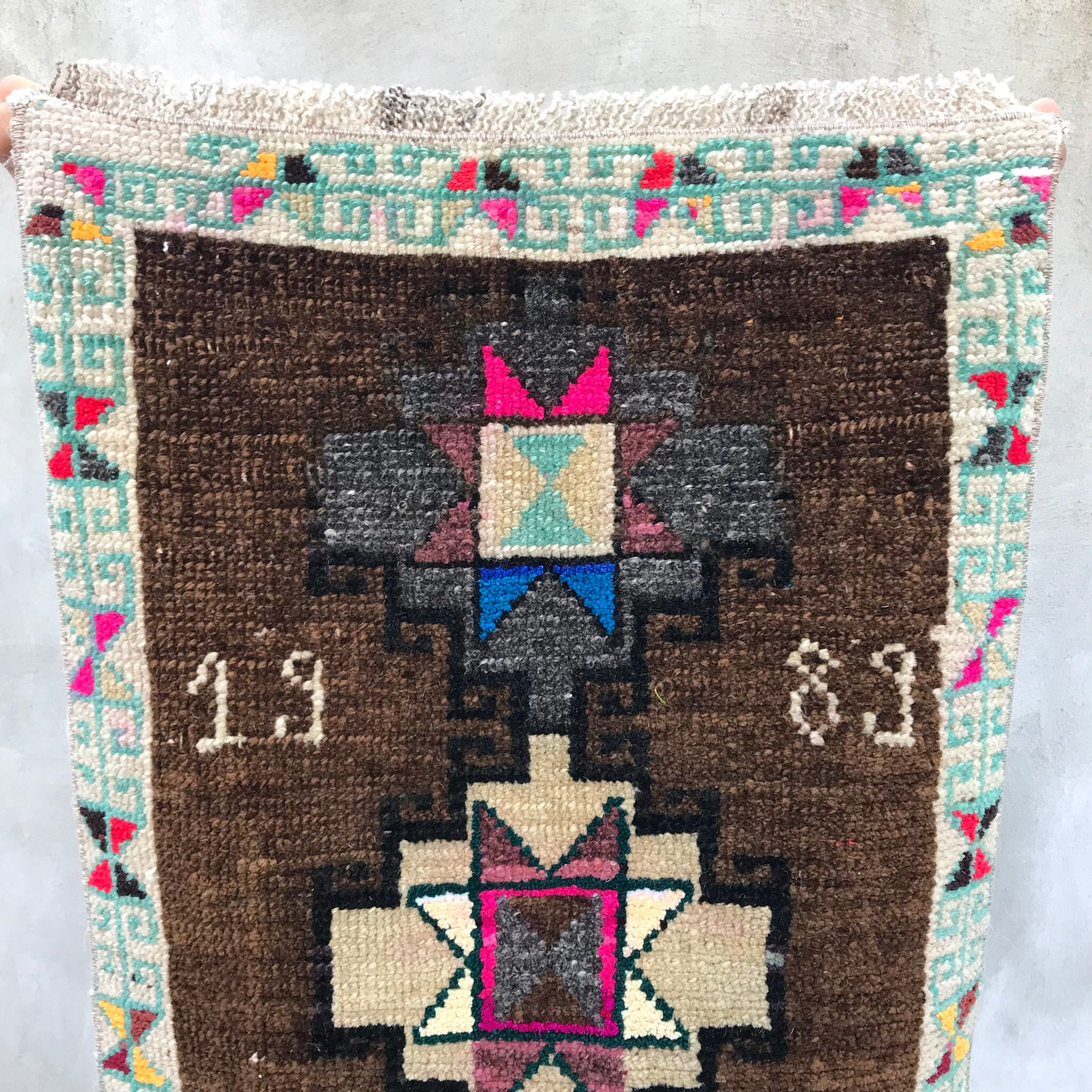 Great little rug with 1989 woven into the design. This vintage Yastik has beautiful colors and a super soft pile.  Great for entryways, bathrooms, kitchens and layering. 1'7x2'10